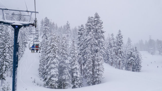 16x9, wide screen. Lift system at ski resort in California, Mammoth mountain. Fir trees covered by white snow - aerial view. Breathtaking winter scenes
