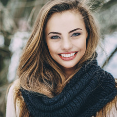 Beautiful smiling winter girl portrait - close up