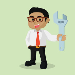 A businessman holding a wrench