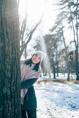 Beautiful woman having fun on winter sunny day