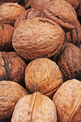 Walnut texture. Brown big walnuts as background. walnut nuts pattern close up photo. Walnuts.