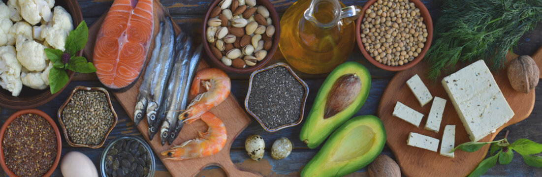 Composition of products containing unsaturated fatty acids Omega 3 - fish, nut, tofu, avocado, egg, soybean, flax, pumpkin seeds, chia, hemp, cauliflower, dill, vegetable oil. Top view. Healthy food