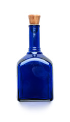 Blue glass bottle with a wooden lid on a clean white background..