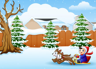 Cartoon boy riding sled on the snowing village pulled by two dogs