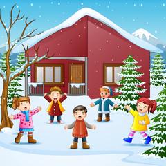 Happy kid singing in the snowing village
