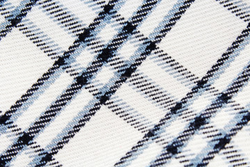 Chequered checked fabric dress material cloth texture pattern. Fabrics closeup.