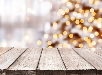 Holidays background with light spots, bokeh and vintage wooden tabletop