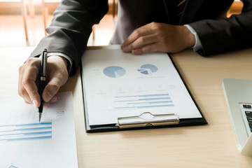 Business executives analysis data document with accountant at workplace