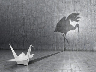 Concept of hidden potential. A paper crane that throws the shadow of a real crane. 3D illustration Wall mural