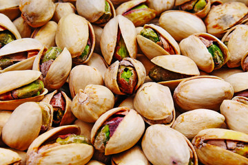 Pistachio texture. Nuts. Green fresh pistachios as texture. Roasted salted pistachio nuts healthy delicious food studio photo. Food.