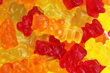 Gummy bear background. Gummy bears as texture. Gum bear candy colorful pattern. Gummy bears.