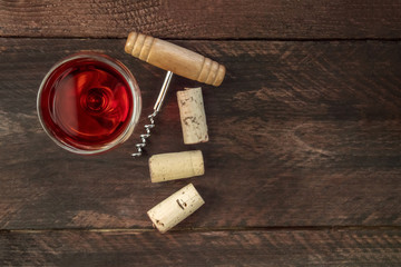 Wine corks, glass, and corkscrew with copy space