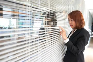 Peeking through blinds