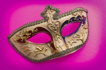 carnival mask on color background