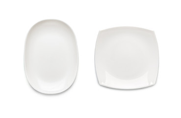 Two white plates of different shapes on a white background. View from above. Isolated..