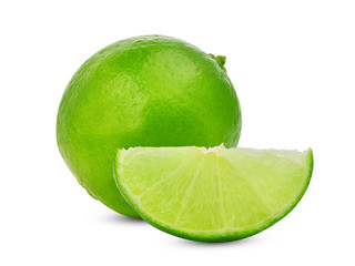 whole and slices fresh green lime isolated on white background