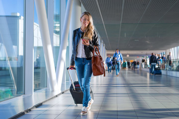 Happy woman travelling and walking in airport