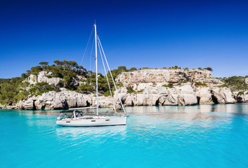 Beautiful bay in Mediterranean sea with sailing boat, Menorca island, Spain