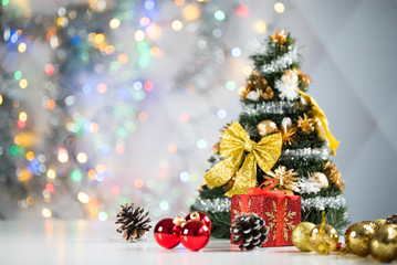 christmas decoration on bright background, gift boxes and tree