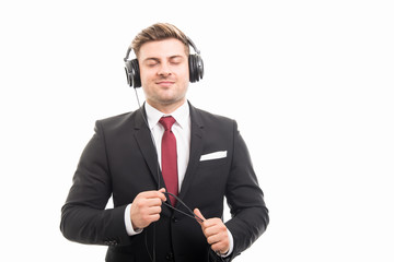 Young manager wearing headphones enjoying music