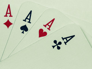 poker game cards isolated with green background