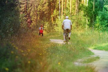 active senior with grandkids riding bikes in nature