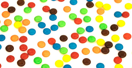 Colorful button shaped chocolates candy isolated