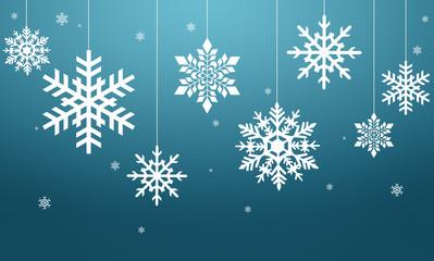 Fototapeta Białe płatki śniegu na niebieskim tle