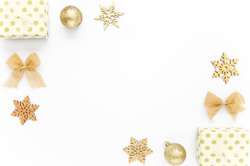 Holiday round frame, pattern made and gold glass Christmas balls, golden leaves isolated on a white background. Merry Christmas. The apartment lay, top view