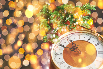 Happy New Year at midnight 2018, Old wooden clock with holiday lights and fir branches