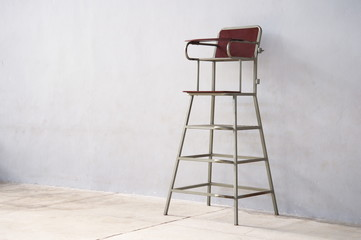 high chair of referee for sport match with cement wall background