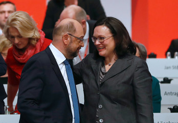 Andrea Nahles speaks with Social Democratic Party (SPD) leader Martin Schulz during an SPD party convention in Berlin