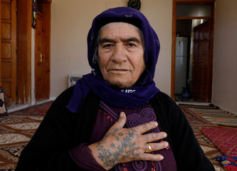 Senem Dogru (80) poses as she speaks about her tattoos at her home in Kisas village in southeastern province of Sanliurfa, Turkey, November 22, 2017. Picture taken November 22, 2017. REUTERS/Umit Bektas