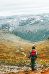 Man hiking trek in mountains with backpack Travel healthy lifestyle concept active weekend summer vacations scandinavian nature