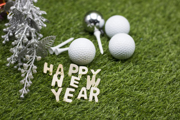 Merry Christmas and Happy New year to golfer on green grass with ornament