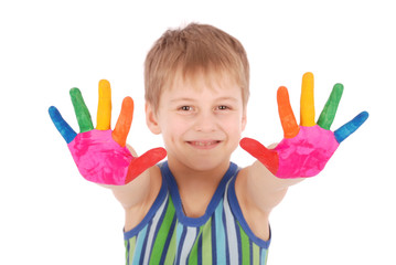Beautiful little boy with hands in the paint