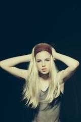 Girl in blonde wig, hairdresser.