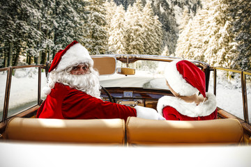 Santa Claus and winter road. Christmas travel time.