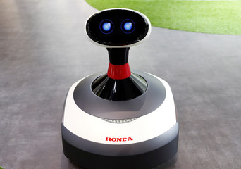 Honda Motor demostrates Ai-miimo, Honda's concept model of AI-installed lawn mower, during media preview of the 45th Tokyo Motor Show in Tokyo