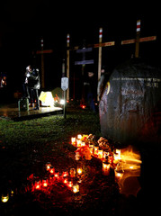 "Man sings song during a ""Night of the executed poets"" event at a mass grave in Kuropaty on the outskirts of Minsk"