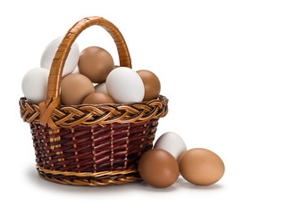 Basket full of white and brown eggs