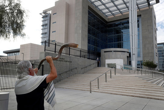Bundy family supporter Brand Thornton blows a shofar outside the federal courthouse as jury selection begins for Nevada rancher Cliven Bundy, two of his sons and co-defendant Ryan Payne, in Las Vegas