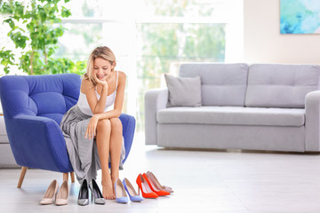 Woman choosing shoes at home