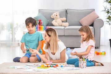Mother with children painting at home
