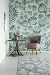 Floral room with pink armchair