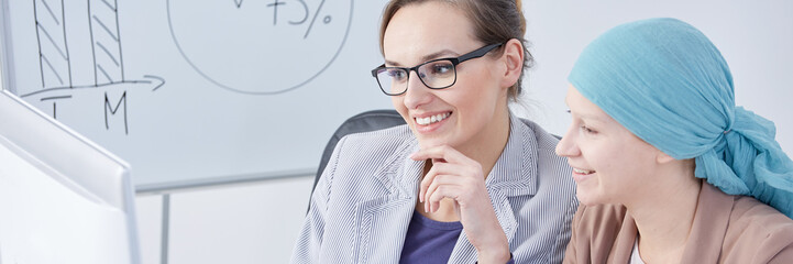 Businesswoman showing presentation to colleague