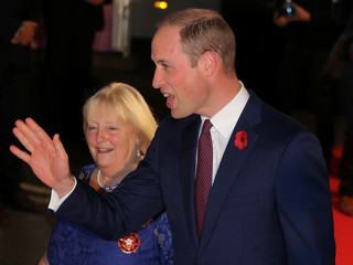 Britain's Prince William waves as he arrives for the Pride of Britain Awards in London