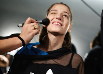 A model has her make up done backstage during the Tbilisi Fashion Week in Tbilisi