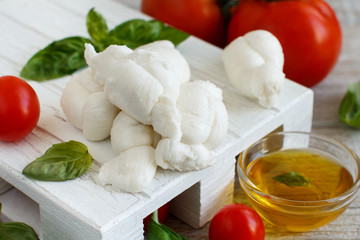 Italian cheese mozzarella nodini with tomatoes and herbs