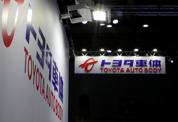 Toyota Auto Body's logos are pictured at the 45th Tokyo Motor Show in Tokyo